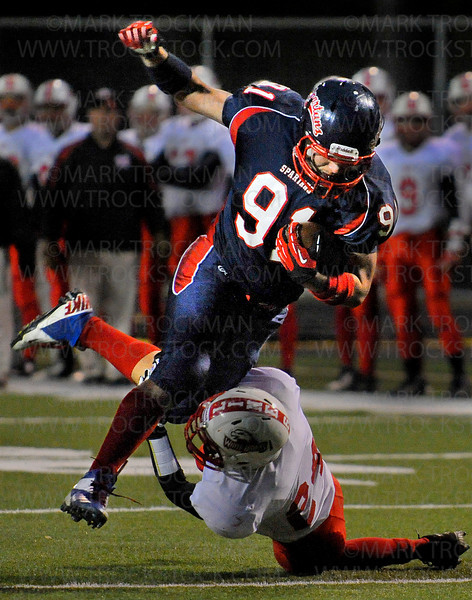 White Hawks DB Ben Rogers, bottom, stops Orono's forward progress after the kickoff Friday at Pesomen Stadium in Orono Oct. 5.  Orono blanked the White Hawks 28-0 in Wright County Conference play.