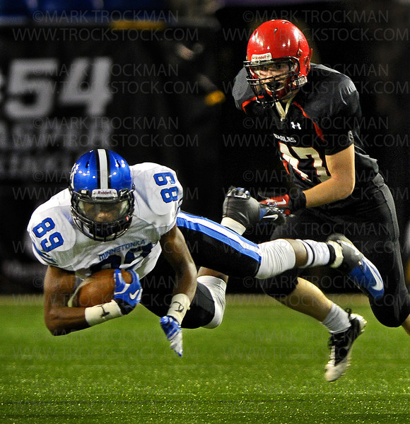 Air Ball.  Minnetonka senior wide receiver Malcom Moore (89) gets horizontal while making yardage against Eden Prairie Friday, Nov. 9, at the Metrodome in Minneapolis.  Eden Prairie topped the Skippers 21-18.