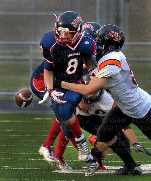 Spartan junior wide receiver Koller Adzick (8) loses the ball in a messy second quarter play against Grand Rapids.  The Spartans recovered the ball and went on to beat the Thunderhawks 35-21 Friday, Oct. 7, in Long Lake.