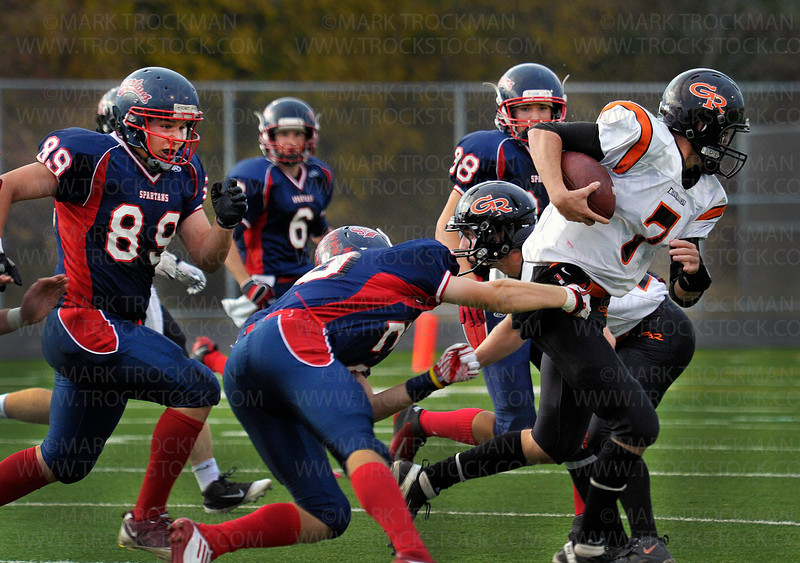 Thunderhawks QB Austin Pohlen (7) is about to be pulled to the turf by Orono's defense late in the first half of the Spartan's 35-21 defeat of Grand Rapids Friday, Oct. 7, in Long Lake.