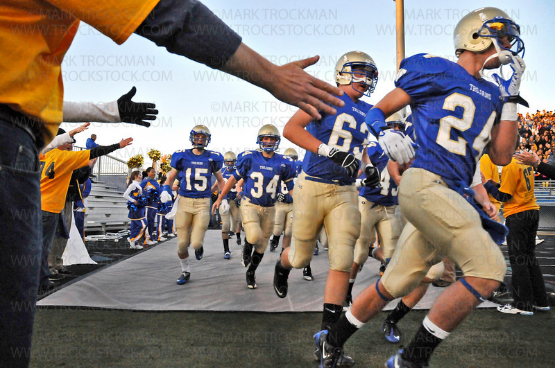 The Wayzata squad enters the field before their homecoming game against Lake Conference rivals Hopkins Friday, Sept. 24, 2010, in Plymouth.  The Trojans beat the Royals 35-14.