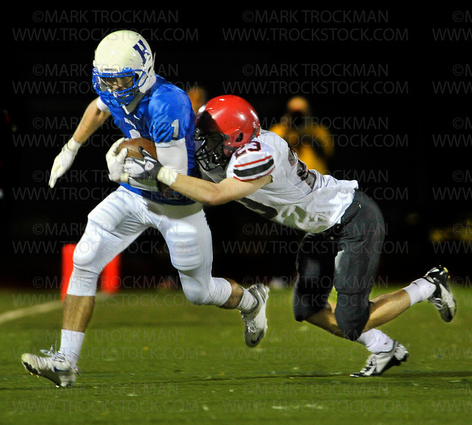 Hopkins senior wide receiver Zac Merie (1) picks up yardage trailing Eden Prairie DB Derek Soderberg in the first half of the Royals 42-21 loss to the Eagles Friday, Sept. 21, at Royals Stadium.