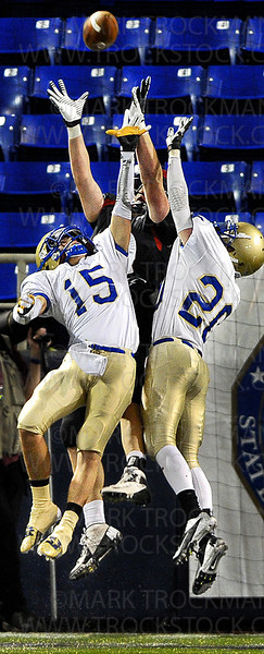 Hail Mary.  Wayzata senior Brett Classen (15) and junior Kyle Kalivoda (20) fight for a long pass that ended in an 18-yard return on an interception Friday, Nov. 16, at the Metrodome in Minneapolis.  The Trojans lost their state semifinal game to last year's state champions, Eden Prairie 21-7.