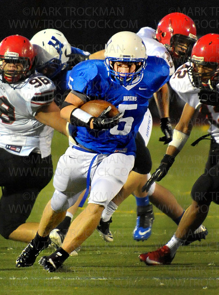 Royals senior running back David Cliett (5) plows past the Eden Prairie secondary in the 2nd quarter Friday, Sept. 21, in Minnetonka.  Hopkins was trounced by the Eagles 42-21.