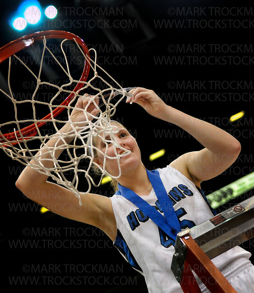Hopkins senior forward Gracia Hutson takes her turn at the traditional cutting down of the net after the Royals beat Osseo 77-55 to clinch the class 4A state championship Saturday night, March 17, at Target Center in Minneapolis.