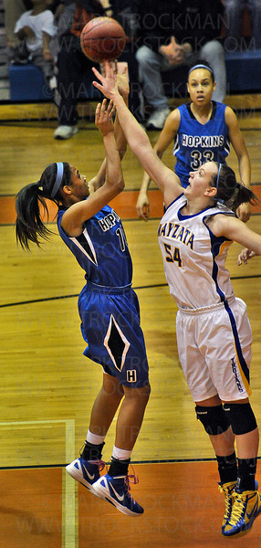 Royals junior guard Nia Coffey, left, puts up two over Wayzata senior Kayla Timmerman (54) in the first half of Hopkins 71-44 section 6-4A tournament defeat of the Trojans Wednesday, March 7, at Osseo High School.