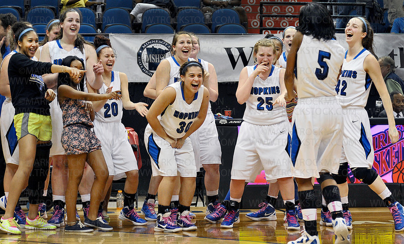Hopkins junior guard Taylor Anderson (5) dances to the delight of her teammates after the Royals decimated Osseo 77-55 to clinch the state class 4A title against Osseo at Target Center Saturday, March 17, 2012.