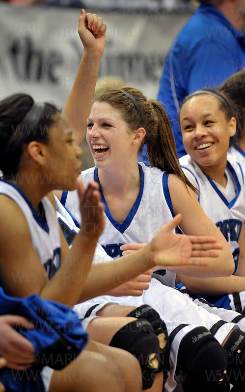 Royals senior standout Julia Wiemer, center, celebrates with her teammates on the bench as the final seconds tick off the clock at Target Center in Minneapolis Saturday night, Mar. 19, 2011.  Hopkins beat Lake Conference rival Eden Prairie 67-45 for the Class 4-A state basketball supremacy.