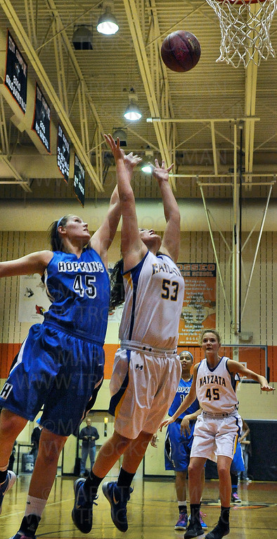 Wazyata senior guard, standout Marissa Grossfeld (53), battles Royals senior forward Gracia Hutson (45) for an offensive rebound in the second half of Hopkins 71-44 section 6-4A tournament defeat of the Trojans Wednesday, March 7, at Osseo High School.