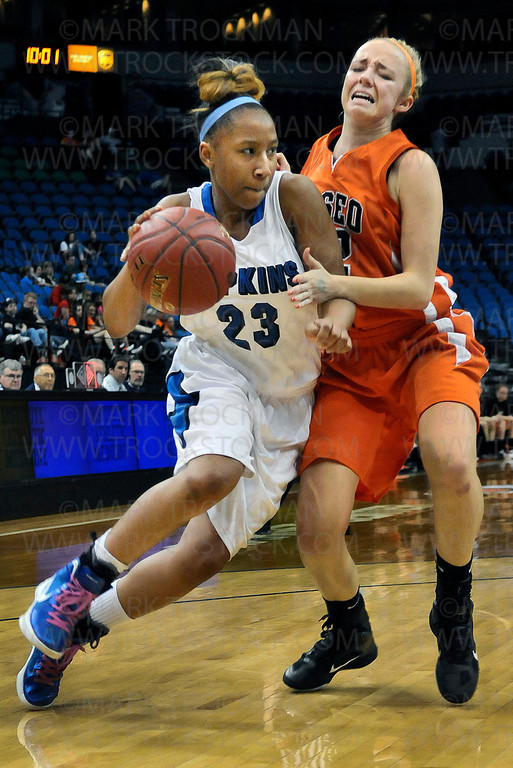 Royals freshman guard Viria Livingston (23) powers past the Osseo defense in second half action at the class 4A state final Saturday, March 17, at Target Center in Minneapolis.  Hopkins crushed the Orioles 77-55 to win the state title for the fourth time since 2004.