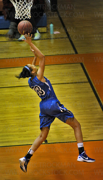 Hopkins senior guard Sydney Coffey scores on a breakaway against Wayzata in the first half of Hopkins 71-44 section 6-4A tournament defeat of the Trojans Wednesday, March 7, at Osseo High School.