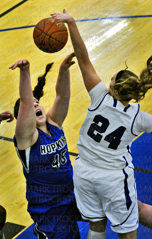 Royals senior forward Erin O'Toole (45) makes a layup past Minnetonka freshman Courtney Fredrickson in first half, Lake Conference, action Friday, Feb. 8, at Hopkins High School.  The Royals sunk the Skippers 78-55.