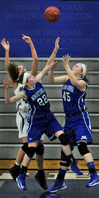 Tonka senior guard Joanna Hedstrom (22) and junior center Olivia Baker (45) fight for a rebound against Holy Family Catholic at Minnetonka High School.  The Skippers beat the Fire 59-46.