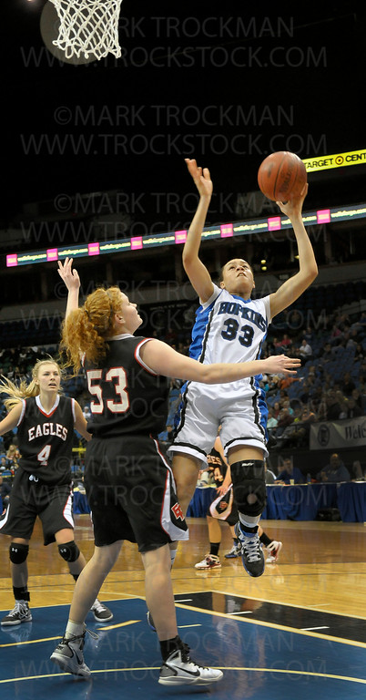 Royals junior guard Sydney Coffey (33) puts up two of her 18 points against Eden Prairie in Hopkins' 67-45 Class 4-A state championship win Saturday, Mar. 19, at Target Center in Minneapolis.