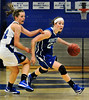 Skippers senior guard Joanna Hedstrom, right, drives toward the basket and through the Eastview defense in the first half of Minnetonka's non-conference, 72-66 loss to the Lightning in non-conference action at Minnetonka High School Thursday, Nov. 29, in Minnetonka.