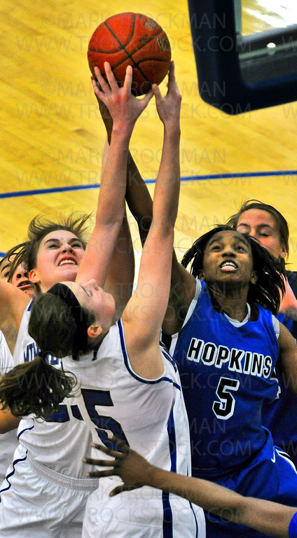 Royals senior guard Taylor Anderson (5), right, fights Skippers junior Anne Hamilton (5) and the Minnetonka squad for a rebound in the first half of the Royals 78-55 Lake Conference spanking of Minnetonka Friday, Feb. 8, at Hopkins High School in Minnetonka.