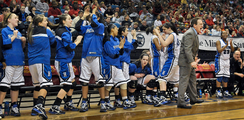 The Hopkins bench erupts behind head coach Brian Cosgriff after another stunning play against Eden Prairie Saturday, Mar. 19, at Target Center in downtown Minneapolis.  The Royals went on to beat Eden Prairie 67-45 for the Class 4-A state championship.