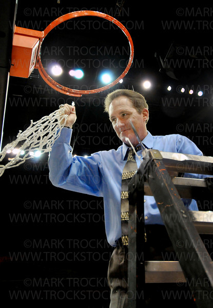 The last snip.  Royals head coach Brian Cosgriff makes the last cut that separates the winning teams' net from the rim after Hopkins soundly beat Eden Prairie 67-45 for the Class 4-A state girls basketball title at Target Center in Minneapolis Saturday, Mar. 19, 2011.