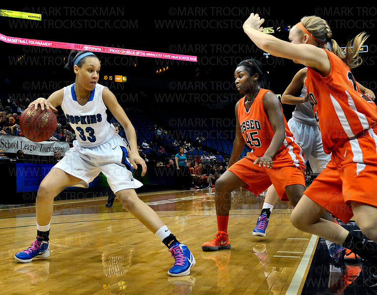 Royals senior guard Sydney Coffey (33) picks her line of attack against the Osseo defense Saturday, March 17, at Target Center in Minneapolis.  Coffey and the Royals went on to crush the Orioles 77-55 and clinch another class 4A state title.