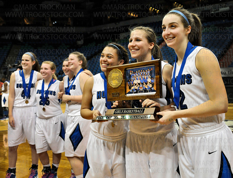 With gold medals around their necks, Hopkins players show off their state class 4A championship trophy to their fans, friends, families and the media after putting down Osseo 77-55 Saturday, March 17, 2012, at Target Center in Minneapolis.