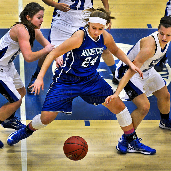 Minnetonka freshman forward Courtney Fredrickson (24) fights to keep a loose ball from the Eastview defense in Thursday's non-conference action at Minnetonka High School.  The Skippers lost to the Lightning 72-66.