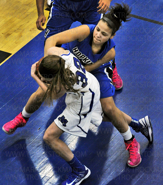 Skippers freshman guard Hannah Hedstrom, left, fights for the ball with Royals freshman Ashley Bates in the first half of the Royals 78-55 Lake Conference spanking of Minnetonka Friday, Feb. 8, at Hopkins High School in Minnetonka.