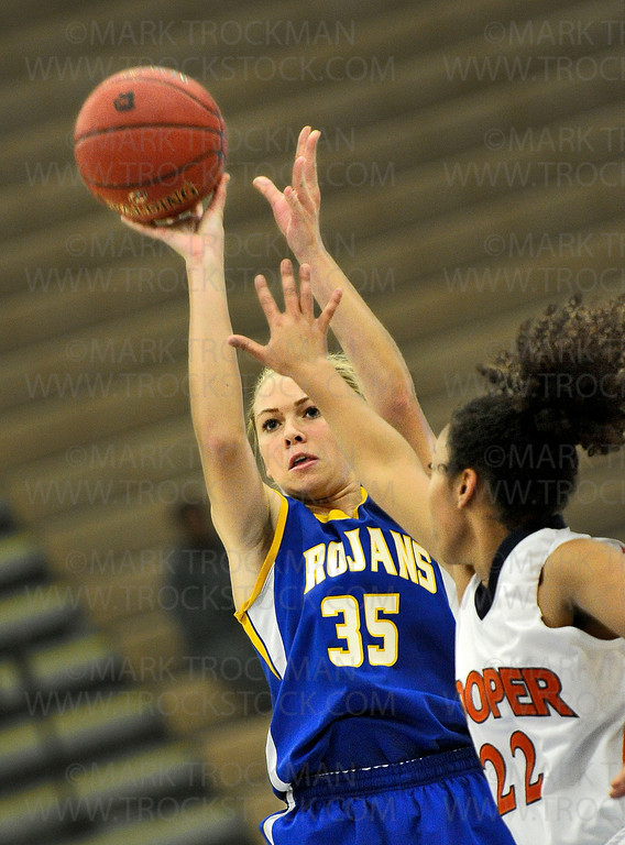 Trojans team captain, senior guard Katie Schulz (35), puts up two of her 24 points as Wayzata beat Cooper 57-54 Wednesday, Dec. 12, in Plymouth.