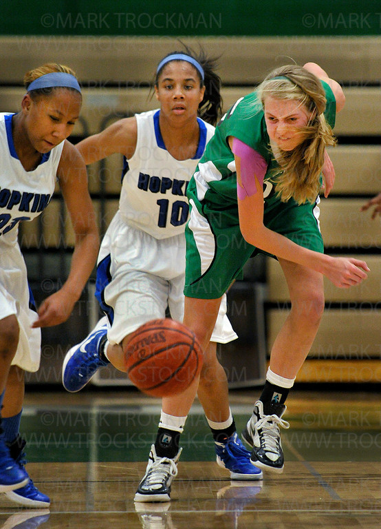 Hopkins standout freshman guard Viria Livingston, left, beats Edina senior Lindsey Johnson, right, to a loose ball in the first half of the Royals 68-46 crushing Lake Conference defeat of the Hornets Tuesday, Jan. 24, at Edina.