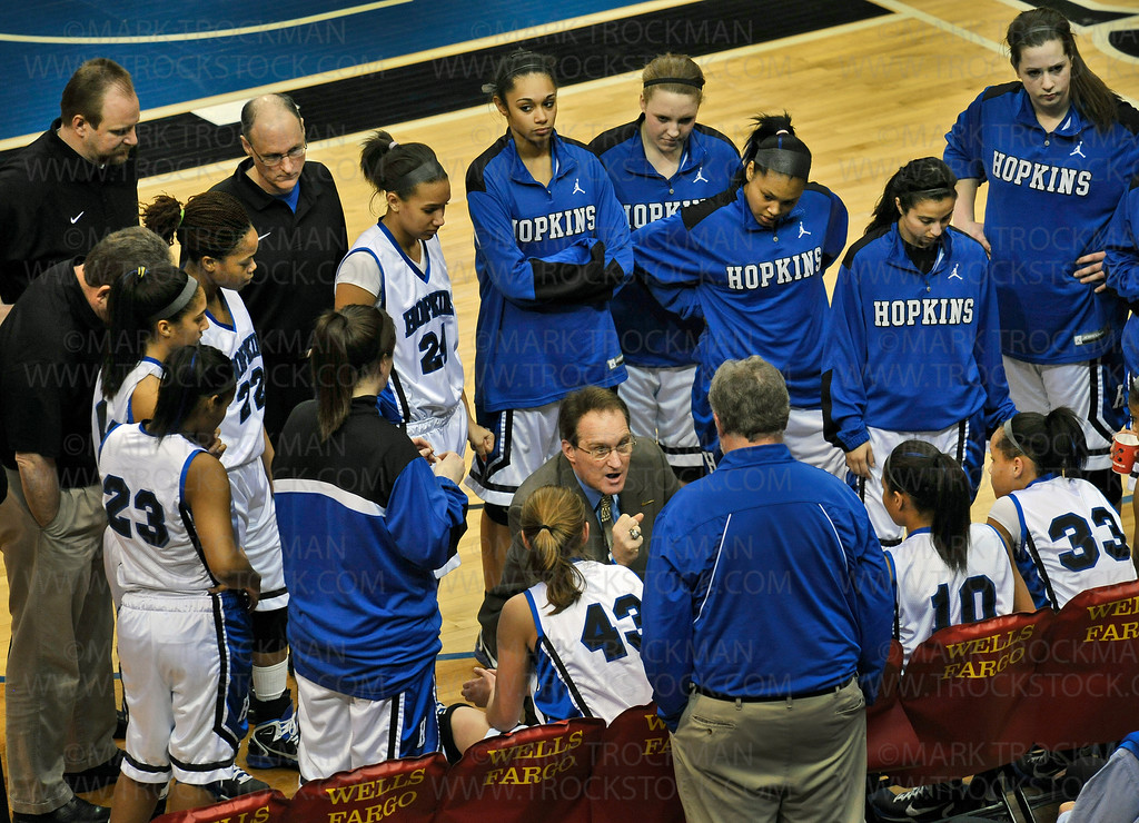 Royals head coach Brian Cosgriff, center, takes an early timeout to work with his team on strategy against Lake Conference foe Eden Prairie at Target Center in Minneapolis Saturday, Mar. 19, 2011.  Hopkins beat the Eagles 67-45 to win the Class 4-A state championship.