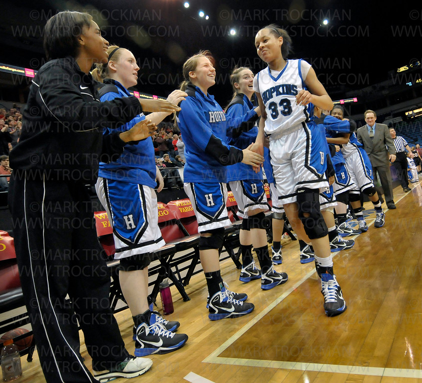 Royals junior guard Sydney Coffey (33) is greeted with exuberant  smiles after her astounding 18-points in Hopkins' 67-45 Class 4-A state championship win Saturday, Mar. 19, against rival Eden Prairie at Target Center in Minneapolis.