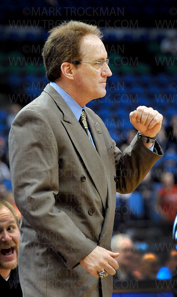 Hopkins girls basketball head coach Brian Cosgriff pumps his fist as the final seconds wear down on his teams' amazing 67-45 Class 4-A state championship win against Eden Prairie Saturday, Mar. 19, at Target Center in Minneapolis.