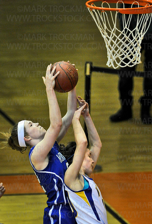 Skippers senior guard Joanna Hedstrom, left, runs into trouble under the basket with Trojans senior guard Summer Johnson during the Section 6-4A tournament Saturday, March 2, at Osseo High School.  Minnetonka beat Wayzata 65-46 in their semifinal matchup.