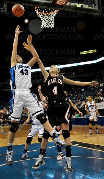 Hopkins forward Gracia Hutson, left, puts in two past Eden Prairie forward Jackie Johnson in the second half of the Royals 67-45 Class 4-A state championship win at Target Center in Minneapolis Saturday, Mar. 19, 2011.