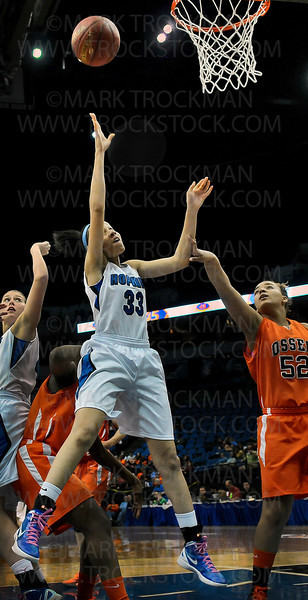 Hopkins senior guard Sydney Coffey (33) puts up two points against Osseo in the second half of the Royals 77-55 class 4A state championship Saturday night, March 17, at Target Center in Minneapolis.