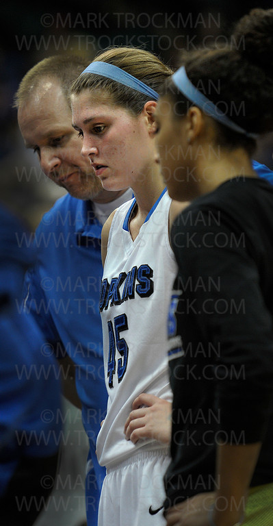 Hopkins senior forward Gracia Hutson, center, listens to head coach Brian Cosgriff (not pictured) strategize during the Royals 77-55 thumping of Osseo in the class 4A state championship game Saturday night, March 17, at Target Center in Minneapolis.