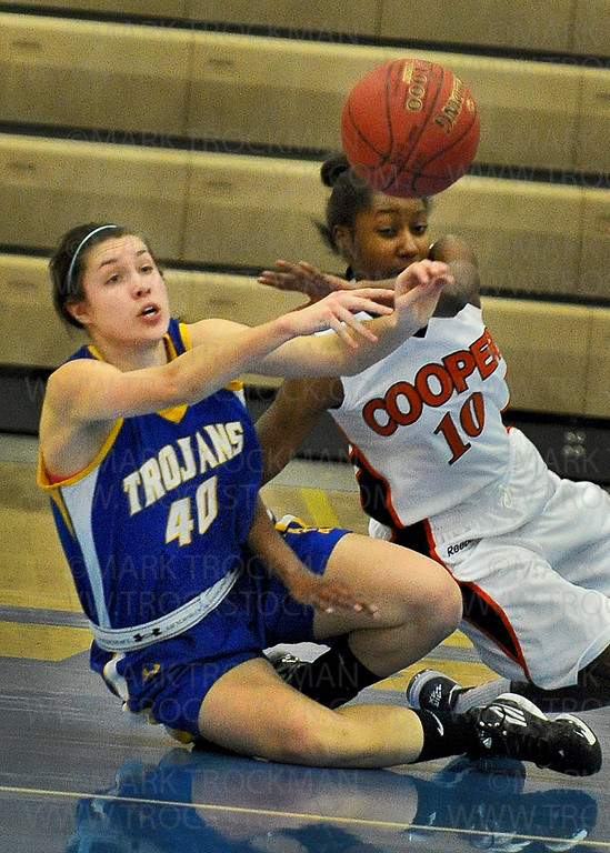 Colliding on the floor, Wayzata senior guard Summer Johnson (40) battles for possession with Cooper guard Chelsey McGee in the first half of the Trojans 57-54 defeat of the Hawks Wednesday, Dec. 12, in Plymouth.