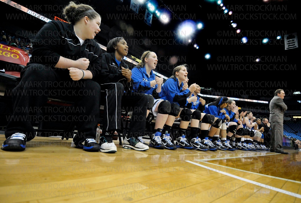Excitement and nervous tension on the Hopkins bench behind head coach Brian Cosgriff, right, was not necessary as the Royals handily beat Eden Prairie 67-45 for the Class 4-A state championship Saturday, Mar. 19, at Target Center in Minneapolis.
