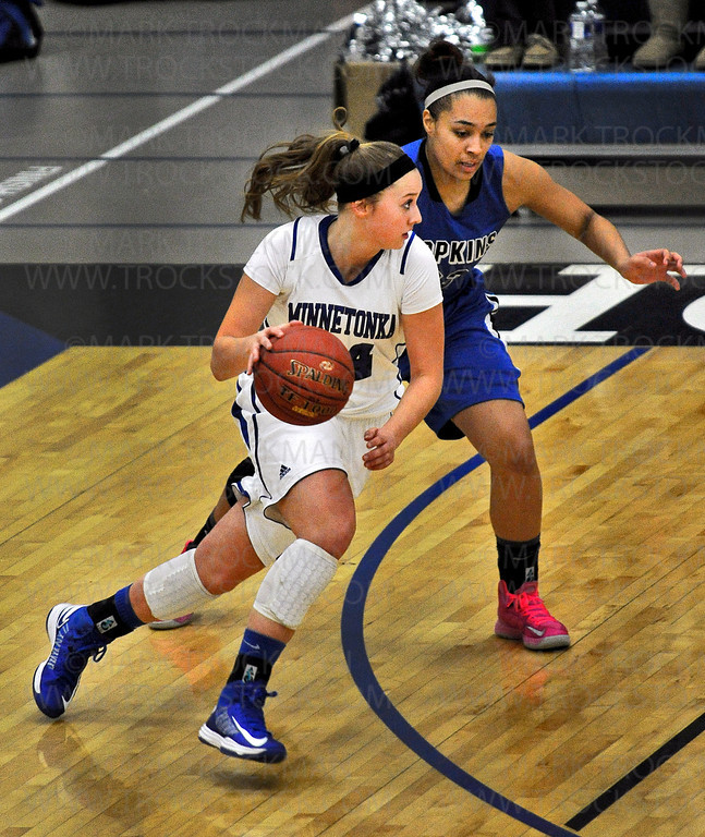 Skippers freshman forward Courtney Fredrickson, left, moves around Royals sophomore guard Viria Livingston at Hopkins High School.  Minnetonka was defeated 78-55 by Lake Conference rival Hopkins Friday, Feb. 8.