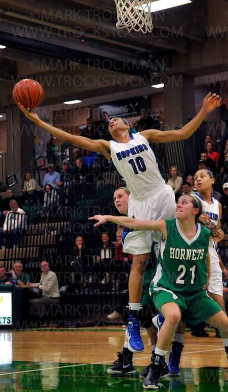 Royals junior guard Nia Coffey (10) slides through the Edina defense to score two of her team-high 15 points Tuesday, Jan. 24 at Edina High School.  Hopkins trounced the Hornets 68-46 in Lake Conference action.