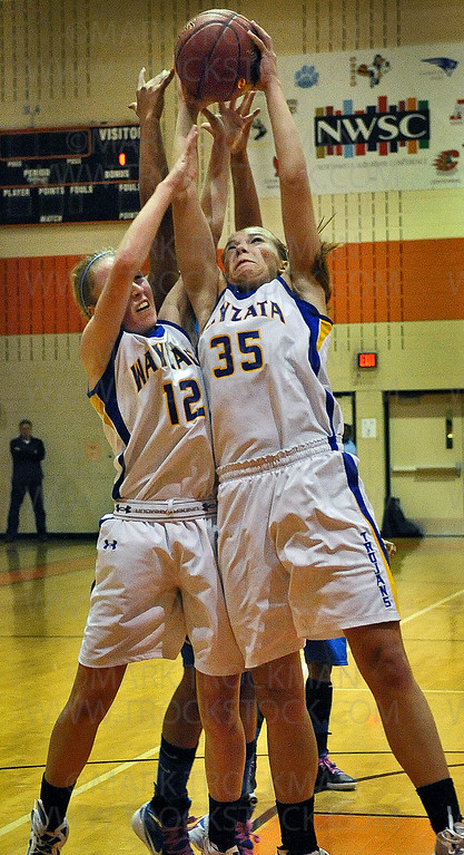Wayzata junior guard Kiana Nickel (12) and junior guard Katie Schulz (35) bring in a defensive rebound in the second half of Hopkins 71-44 section 6-4A tournament defeat of the Trojans Wednesday, March 7, at Osseo High School.