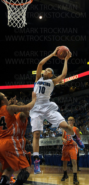 Hopkins junior guard Nia Coffey (10) pulls in an offensive rebound while Osseo players can only watch as the Royals proceed to beat the Orioles 77-55 for the state class 4A title Saturday, March 17, 2012, at Target Center in Minneapolis.