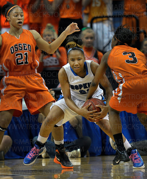 Royals freshman guard Viria Livingston, center, battles for possession with Osseo's Anuli Okonkwo in second half action in the class 4A state final Saturday, March 17, at Target Center in Minneapolis.  Hopkins crushed the Orioles 77-55 to win the state title for the fourth time since 2004.
