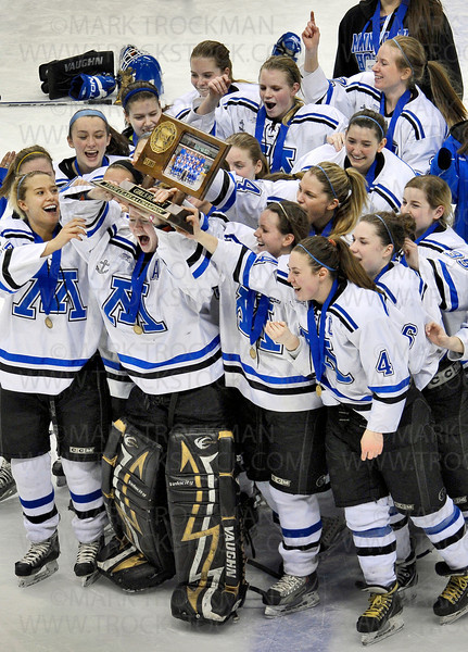 Led by an exuberant Julie Friend, the 2011 Minnetonka girls hockey team shows off their hard won hardware to their fans Saturday, Feb. 26, at the Xcel Energy Center in St. Paul.  The Skippers beat Edina to win the Class 2A state championship.