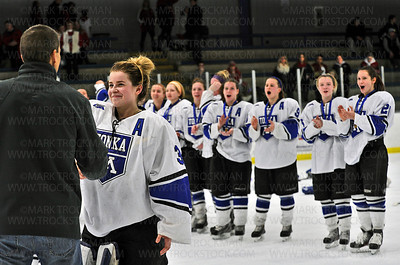 Minnetonka senior goalie Sydney Rossman receives her first place medal to the cheers of her teammates after the Skippers defeated Benilde-St. Margaret's 3-2 to win the 2013 section 6-2A girls hockey tournament Friday, Feb. 15 at Parade Ice Garden in Minneapolis.