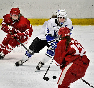 Skippers senior forward Laura Bowman, center, moves through the Red Knights defense in 1st period action Friday, Feb. 15 at Parade Ice Garden in Minneapolis.  Minnetonka beat Benilde-St. Margaret's 3-2 to clinch the 2013 section 6-2A girls hockey tournament win.