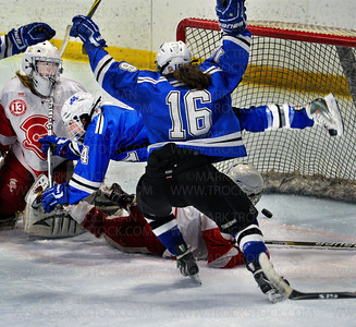 With the the puck already bouncing off the back of the net, Skippers sophomore forward Diana Draayer, center, seems suspended horizontally while teammate Laura Bowman (16) salutes their victory and Draayer's overtime goal that ended the Benilde-St. Margaret season for 2012.  Minnetonka eliminated the Red Knights 2-1 in sudden death overtime Friday, Feb. 17, at Parade Ice Garden in Minneapolis.