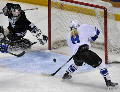 Minnetonka sophomore Sydney Baldwin (8) follows a first period goal against Roseville into the net.  The Skippers clinched the 2012 Class 2-A championship Saturday, Feb. 25, at the Excel Energy Center in St. Paul with a 3-0 shutout of the Raiders.