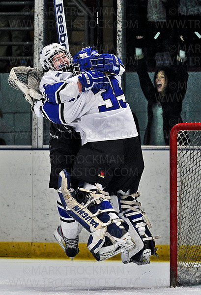 Skippers senior defender Sidney Morin, left, and senior goalie Sydney Rossman, celebrate in mid-air Minnetonka's 3-2 defeat of Benilde-St. Margaret's to clinch the 2013 section 6-2A girls hockey tournament Friday, Feb. 15 at Parade Ice Garden in Minneapolis.