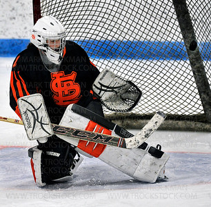 Orioles sophomore goalie Anna Gleason (1) makes a stick save against Jefferson Saturday, Jan. 17, at Bloomington Ice Garden.