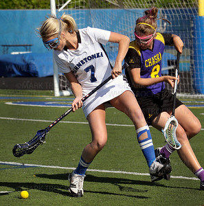 Minnetonka senior Julia Dales (7) keeps a loose ball from the Storm Hawks Erin McNeill in the first half of the Skippers 19-7 Section 6-2A Girls' Lacrosse Tournament win Thursday, May 26, at Minnetonka High School.
